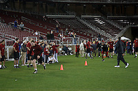 """9 February 2007: Fans watch the team practice during a """"Friday Night Lights"""" practice at Stanford Stadium in Stanford, CA."""