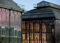 Plant History Glasshouse (formerly Australian Glasshouse) on the left and New Caledonia Glasshouse (formerly The Mexican Hothouse) on the right, 1834, Charles Rohault de Fleury, Jardin des Plantes, Museum d'Histoire Naturelle, Paris, France; seen in the morning light, with the sunlit interior wall of the New Caledonia Glasshouse fully visible in the photograph.