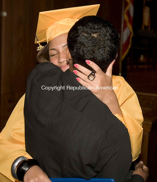WATERBURY, CT --JUNE 16, 2008-061608JS10-Kennedy High School graduate Keyla Cruz receives a hug from her boyfriend Jami Rodriguez after receiving her dilpoma during Monday's commencement exercises at Kennedy High School in Waterbury. <br /> Jim Shannon/Republican-American