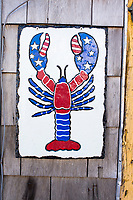 "A tile with a lobster painted in an American flag theme hangs near the front door at Island Seafood's ""bait shop"" where fishermen bring lobsters to sell to the dealer in on Badger's Island in Kittery, Maine, USA, on Wed., Jan. 31, 2018."