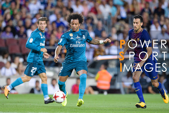 Marcelo da Silva of Real Madrid (L) plays against Sergio Busquets of FC Barcelona (R) during the Supercopa de Espana Final 1st Leg match between FC Barcelona and Real Madrid at Camp Nou on August 13, 2017 in Barcelona, Spain. Photo by Marcio Rodrigo Machado / Power Sport Images