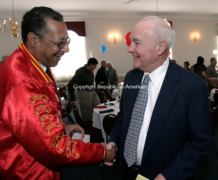 WATERBURY, CT, 24 May 2006- 052406BZ05- Sam Beamon, Jr. Vice Commandant, Department of Connecticut, U.S. Marine Corp League, left, greets fellow Vietnam Veteran, Judge William Sullivan, senior justice on the Sate Of Connecticut Supreme Court, during the Waterbury Veterans Remembrance Dinner at Daniel's Fine Catering in Waterbury Wednesday night.<br /> Jamison C. Bazinet Republican-American