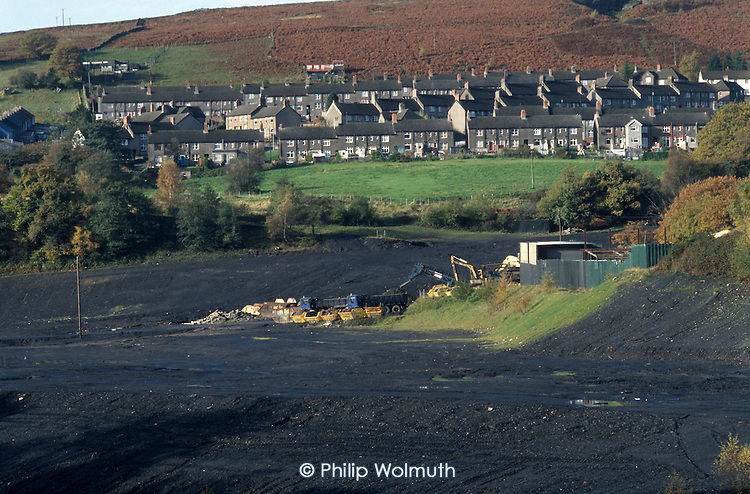 Bulldozed site of a demolished colliery in the village of Treharris, South Wales