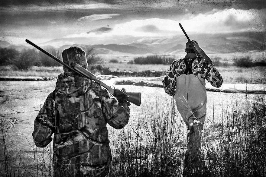 Hunter search for waterfowl on the Red Rock River near Dillon, Montana.