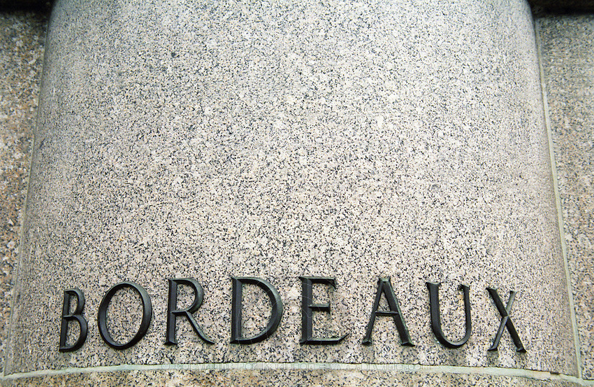 "Bordeaux"" in big letters metal on stone on the foot pedestal of a statue. Bordeaux City, Bordeaux Gironde Aquitaine France Europe"