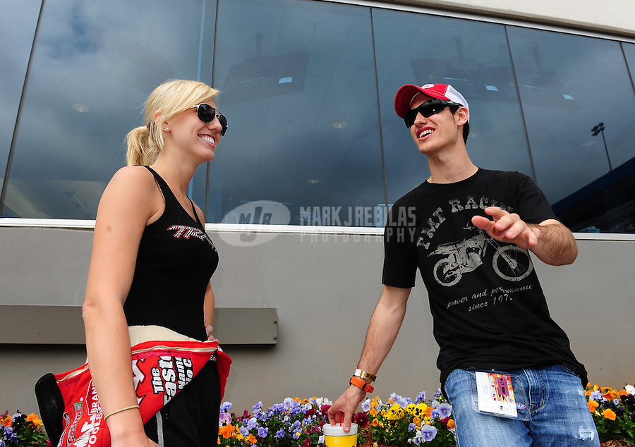 Apr. 15, 2012; Concord, NC, USA: NHRA funny car driver Courtney Force (left) with NASCAR driver Joey Logano during the Four Wide Nationals at zMax Dragway. Mandatory Credit: Mark J. Rebilas-