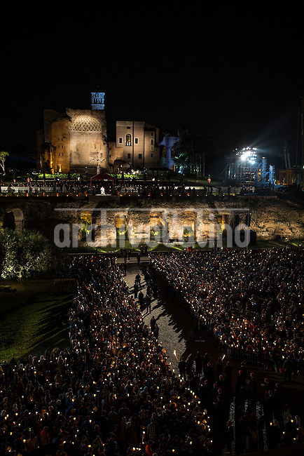 Rome, Italy, April 14 2017.About 20,000 faithful were present tonight, at the traditional Via Crucis (Way of the Cross) presided over by Pope Francis near the Colosseum in Rome. With much security amidst a climate of meditation and prayer, thousands of small flames of the candles that illuminated the night.