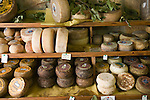 Italian cheese rounds in a shop, Pienza, Italy. In 1996, UNESCO declared the town a World Heritage Site. Taken during revisit with the Pellegrini family, 2005, Pienza, Italy. The Pellegrinis were Italy's participants in Material World: A Global Family Portrait, 1994 (pages: 198-199), for which they took all of their possessions out of their house for a family-and-possessions-portrait.