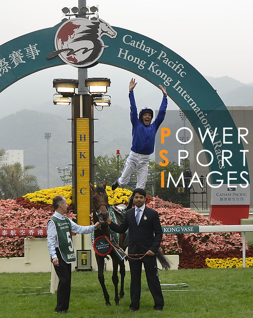 HONG KONG - DECEMBER 12:  Italian jockey Frankie Dettori jumps from Mastery after winning the Cathay Pacific Hong Kong Vase during the Cathay Pacific International Races at the Sha Tin Racecourse on December 12, 2010 in Hong Kong, Hong Kong. Photo by Victor Fraile / The Power of Sport Images