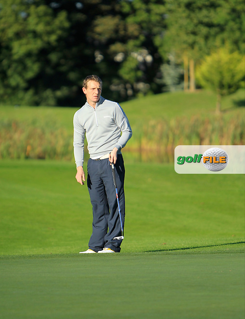 Gareth McCausland (Ballyliffin G.C) on the 12th green during Round 1 of The Cassidy Golf 103rd Irish PGA Championship in Roganstown Golf Club on Thursday 10th October 2013.<br /> Picture:  Thos Caffrey / www.golffile.ie