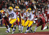 NWA Media/ANDY SHUPE - Arkansas' Braylon Mitchell, right, reaches to tackle LSU's Terrence Magee (18) during the third quarter Saturday, Nov. 15, 2014, at Razorback Stadium in Fayetteville.