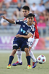 14 June 2014: Carolina's Cesar Elizondo (CRC) (7) and Chivas USA's Carlos Alvarez (behind). The Carolina RailHawks of the North American Soccer League played Chivas USA of Major League Soccer at WakeMed Stadium in Cary, North Carolina in the fourth round of the 2014 Lamar Hunt U.S. Open Cup soccer tournament. The RailHawks advanced by winning a penalty kick shootout 3-2 after the game had ended in a 1-1 tie after overtime.