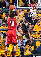 David Kravish of California tries to block the shot from Aaron Gordon of Arizona during the game at Haas Pavilion in Berkeley, California on February 1st, 2014.  California Golden Bears defeated Arizona Wildcats, 60-58.