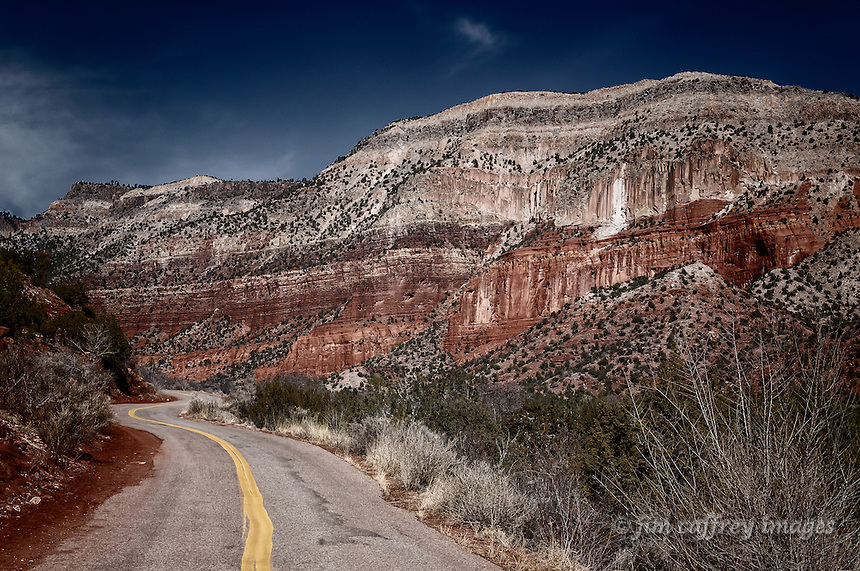 New Mexico highway 485 as it winds its way through Guadalupe Canyon north of the village of Gilman before it enters the Santa Fe National Forest.