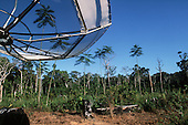 Juruena, Mato Grosso State, Brazil. Satellite dish for television in a remote settler farm in recently deforested area.