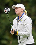 SIOUX FALLS, SD - SEPTEMBER 23: Megan Mingo from South Dakota State University watches her tee shot through the rain on the 13th hole of the final round at the 2014 Jackrabbit Invitational Tuesday morning at Minnehaha Country Club.(Photo by Dave Eggen/Inertia)