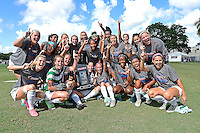 8 November 2015:  North Texas' team celebrates with the championship trophy after the University of North Texas Mean Green defeated the Marshall University Thundering Herd, 1-0, in the Conference USA championship game at University Park Stadium in Miami, Florida.