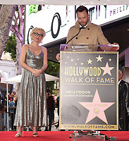 HOLLYWOOD, CA - JANUARY 8: Joel McHale speaks as Gillian Anderson is honored with a star on The Hollywood Walk of Fame on on January 8, 2018 in Los Angeles, California. (Photo by Frank Micelotta/Fox/PictureGroup)