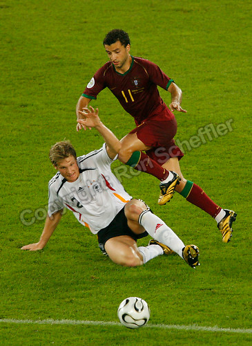 Jul 8, 2006; Stuttgart, GERMANY; Germany defender (2) Marcell Jansen tackles Portugal forward (11) Simao Sabrosa during first half play in the runner-up match to decide third place in the 2006 FIFA World Cup at Gottlieb-Daimler-Stadion, Stuttgart. Mandatory Credit: Ron Scheffler-US PRESSWIRE Copyright © Ron Scheffler