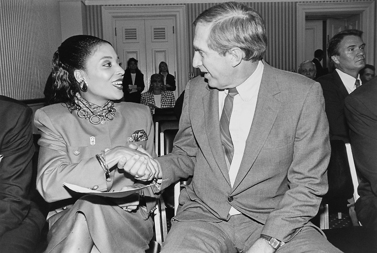 Gold Medalist in Triple Jump Florence Griffith Joyner meets Rep. Joel Hefley, R-Colo., on May 13, 1991. (Photo by Laura Patterson/CQ Roll Call via Getty Images)