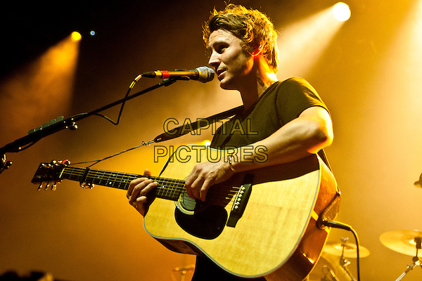 British singer/songwriter Ben Howard plays the UEA, Norwich, UK in support of his debut album 'Every Kingdom' which was released in September 2011 on Island Records..February 22nd 2012.on stage in concert live gig performance performing music half length guitar black t-shirt singing profile .CAP/PP/MM.©Mike Mustard/PP/Capital Pictures