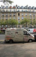 Graffiti on vehicle in Paris street