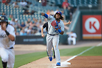 Buffalo Bison third baseman Vladimir Guerrero Jr. (47) makes a throw to home plate to nail Jake Elmore (3) of the Charlotte Knights trying to score at BB&T BallPark on August 14, 2018 in Charlotte, North Carolina. The Bison defeated the Knights 14-5.  (Brian Westerholt/Four Seam Images)