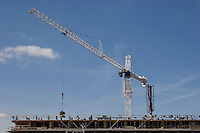 CRANE<br /> Lifting and Positioning Cement Bucket<br /> Above multi-level apartment building.