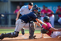 Mobile BayBears catcher Jack Kruger (10) tags Ben Rortvedt (1) sliding home during a Southern League game against the Mobile BayBears on July 25, 2019 at Blue Wahoos Stadium in Pensacola, Florida.  Pensacola defeated Mobile 2-1 in the first game of a doubleheader.  (Mike Janes/Four Seam Images)