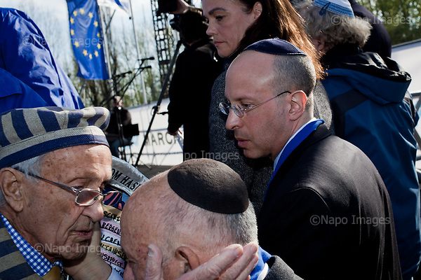 OSWIECIM, POLAND, APRIL 24, 2017:<br /> Elisha Wiesel, looking at the holocaust survivors, Nate Leipciger on the left, during the &quot;March of The Living&quot; an annual march between two camps of the Auschwitz concentration camp.  Elisha Wiesel is a chief technology officer at Goldman Sachs in New York and the only son of Holocaust memoirist Eli Wiesel. After death of his father he has decided to step forward and take a more public role, carrying on his father's work.<br /> (Photo by Piotr Malecki / Napo Images)<br /> ###<br /> OSWIECIM, 24/04/2017:<br /> Elisha Wiesel, syn slawnego Eli Wiesela, bierze udzial w Marszu Zywych w Oswiecimiu. Po smierci ojca Elisha postanowil kontynuoawc jego dzielo.<br /> Fot: Piotr Malecki / Napo Images<br /> <br /> ###ZDJECIE MOZE BYC UZYTE W KONTEKSCIE NIEOBRAZAJACYM OSOB PRZEDSTAWIONYCH NA FOTOGRAFII###