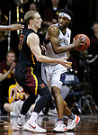 SIOUX FALLS, SD: MARCH 22:  Jalin Alexander #2 of Queens (NC) shields the ball from Northern State defender Darin Peterka #22 during their game at the 2018 Division II Men's Basketball Championship at the Sanford Pentagon in Sioux Falls, S.D. (Photo by Dick Carlson/Inertia)