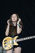 HAIM - Alana Haim - performing live on the Pyramid Stage on Day One at the 2013 Glastonbury Festival held at Pilton Farm Pilton Somerset UK - 28 Jun 2013.  Photo credit: George Chin/IconicPix