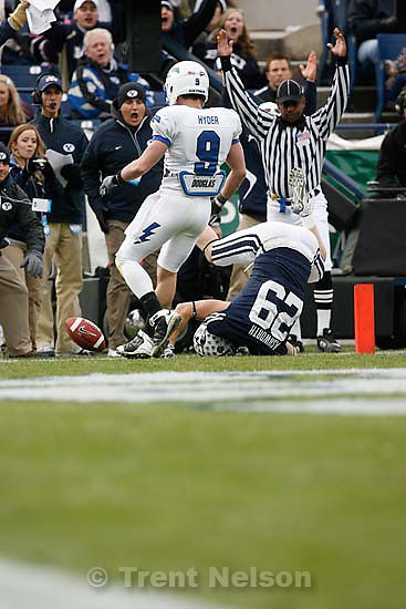 BYU's Luke Ashworth (29) scores a touchdown ahead of Air Force's Luke Hyder (9). BYU vs. Air Force college football Saturday, November 21 2009.