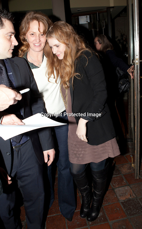 December 15th 2010..Amy Adams making a funny crazy face as she left Ago Restaurant in Los Angeles. Amy was walking with her friend Melissa Leo as she stopped to sign autographs. George Clooney Orlando Bloom & Miranda Kerr were also eating dinner inside but they snuck out the back door. ..AbilityFilms@yahoo.com.805-427-3519.www.AbilityFilms.com