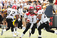 July 10, 2010; Hamilton, ON, CAN; Calgary Stampeders quarterback Henry Burris (1) hands off to running back Joffrey Reynolds (21). CFL football: Calgary Stampeders vs. Hamilton Tiger-Cats at Ivor Wynne Stadium. The Tiger-Cats lost against the Stampeders 23-22. Mandatory Credit: Ron Scheffler. Copyright (c) 2010 Ron Scheffler.