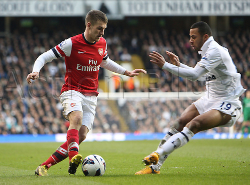 03.03.2013. London, England.Aaron Ramsey of Arsenal and Mouusa Dembele of Tottenham Hotspur  during the Premier League game between Tottenham Hotspur and Arsenal from White Hart Lane