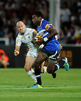 20130801 Copyright onEdition 2013 ©<br /> Free for editorial use image, please credit: onEdition.<br /> <br /> Paul Hodgson of Worcester Warriors 7s (left) looks determined to tackle Tuvita Tamatawale of Bath Rugby 7s during the J.P. Morgan Asset Management Premiership Rugby 7s Series.<br /> <br /> The J.P. Morgan Asset Management Premiership Rugby 7s Series kicks off for the fourth season on Thursday 1st August with Pool A at Kingsholm, Gloucester with Pool B being played at Franklin's Gardens, Northampton on Friday 2nd August, Pool C at Allianz Park, Saracens home ground, on Saturday 3rd August and the Final being played at The Recreation Ground, Bath on Friday 9th August. The innovative tournament, which involves all 12 Premiership Rugby clubs, offers a fantastic platform for some of the country's finest young athletes to be exposed to the excitement, pressures and skills required to compete at an elite level.<br /> <br /> The 12 Premiership Rugby clubs are divided into three groups for the tournament, with the winner and runner up of each regional event going through to the Final. There are six games each evening, with each match consisting of two 7 minute halves with a 2 minute break at half time.<br /> <br /> For additional images please go to: http://www.w-w-i.com/jp_morgan_premiership_sevens/<br /> <br /> For press contacts contact: Beth Begg at brandRapport on D: +44 (0)20 7932 5813 M: +44 (0)7900 88231 E: BBegg@brand-rapport.com<br /> <br /> If you require a higher resolution image or you have any other onEdition photographic enquiries, please contact onEdition on 0845 900 2 900 or email info@onEdition.com<br /> This image is copyright the onEdition 2013©.<br /> <br /> This image has been supplied by onEdition and must be credited onEdition. The author is asserting his full Moral rights in relation to the publication of this image. Rights for onward transmission of any image or file is not granted or implied. Changing or deleting Copyright information is illegal as specified in the Copyright, Design and Patents Act 1988. If you are in any way unsur