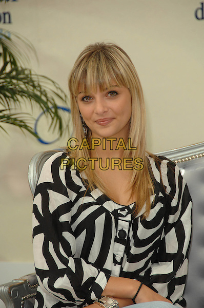 "PRISCILLA.Photocall promoting the television series ""Chante"" during the 2008 Monte Carlo Television Festival held at Grimaldi Forum, Monaco, Principality of Monaco..June 12th, 2008.half length black white pattern top .CAP/TTL .© TTL/Capital Pictures"