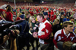 ESPN reporter Erin Andrews interviews Wisconsin Badgers head coach after they beat the Ohio State Buckeyes during an NCAA college football game on October 16, 2010 at Camp Randall Stadium in Madison, Wisconsin. The Badgers beat the Buckeyes 31-18. (Photo by David Stluka)