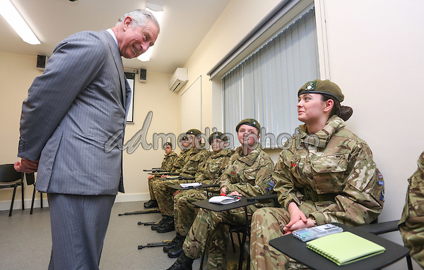 17 February 2016 - Redcar, United Kingdom - Prince Charles The Prince of Wales asks young cadets about rifle training while visiting the new Redcar Joint Cadet Facility to meet young cadets from the Army Cadet Force and the Air Training Corps. His Royal Highness heard about their training and role in the local community. Photo Credit: Alpha Press/AdMedia