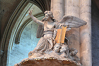 Angel sculpture pointing to heaven and holding a book of the law, 1773, by Jean-Baptiste Michel Dupuis, 1698-1780, above a gilded wood pulpit designed by Pierre-Joseph Christophle, 1715-1782, at the Basilique Cathedrale Notre-Dame d'Amiens or Cathedral Basilica of Our Lady of Amiens, built 1220-70 in Gothic style, Amiens, Picardy, France. Amiens Cathedral was listed as a UNESCO World Heritage Site in 1981. Picture by Manuel Cohen