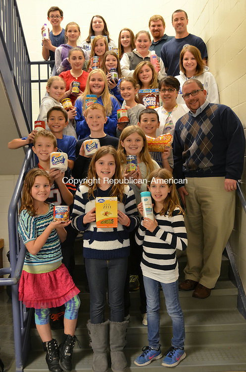 BURLINTON, CT-22 November 2013- 112213AG01- Students and staff from Har-Bur Middle School donated four vans of food and nonperishable items to the local food pantries Friday.  Alexa Gorman Republican-American