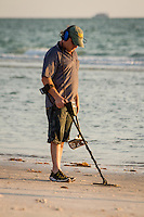 Coin search with Garrett ATpro metal detector along Gulf of Mexico at beach near historic Naples Fishing Pier, Naples, Florida, USA, June 3, 2012. Photo by Debi Pittman Wilkey/News-Press.com.
