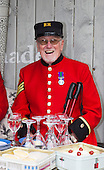 London, UK, 18 May 2013. Chelsea Pensioners at the Nicholsons.garden design stand. Press preview day at the RHS Chelsea Flower Show, London.