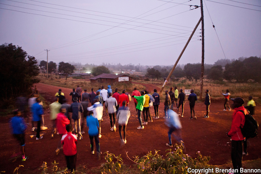 A group of Kenyan runners begin their 18 kilometer morning run in the high altitude town of Iten, Kenya. Perched at 7800 feet atop the Rift Valley escarpment in western Kenya the town is home to generations of  international  track and road running champions. Kenya's marathon runners regularly win major international competitions and hold world records and  track records. It is here that the revolution in marathon running has  been taking place since 2009.