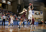 SIOUX FALLS, SD - FEBRUARY 28:  Teagan Molden #30 from the University of Sioux Falls spots up for a jumper over Katrina Nordick #21 from Minnesota Crookston during their NSIC Tournament Sunday at the Sanford Pentagon. (Photo by Dave Eggen/Inertia)