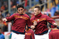 Calcio, Serie A: Roma-Genoa. Roma, stadio Olimpico, 12 gennaio 2014.<br /> AAS Roma defender Nicolas Burdisso, of Argentina, and captain Francesco Totti, right, warm up prior to the start of the Italian Serie A football match between AS Roma and Genoa, at Rome's Olympic stadium, 12 January 2014. <br /> UPDATE IMAGES PRESS/Isabella Bonotto