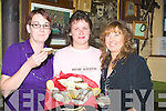 ANNUAL: Josephine Muvihill (Tarbert), Maria Hanrahan O'Neill (Ballylongford) and Matilda O'Toole (Lispole) who entered the ladies swollowing oyster in conjuction with the Ballylongford Oyster Festival on Friday night......