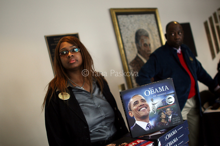 (L-R) Annette Thompson, 42, in human resources for DuSable, and Raymond Ward, PR for DuSable, (with a Harold Washington mosaic behind,) sell books while people have breakfast before watching the inauguration of Barack Obama as President of the United States in the theater of the DuSable Museum of African-American History in Chicago, Illinois, on the Presidential Inauguration Day, Tuesday, January 20, 2009.  (Photo by Yana Paskova for The New York Times)..Assignment ID: 30075164A