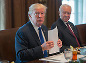 United States President Donald J. Trump makes remarks about tax reform during a bicameral meeting at the White House in Washington, DC on December 13, 2017.  Seated at right is US Senator Orrin Hatch (Republican of Utah), Chairman of the US Senate Committee on Finance.<br /> Credit: Chris Kleponis / CNP
